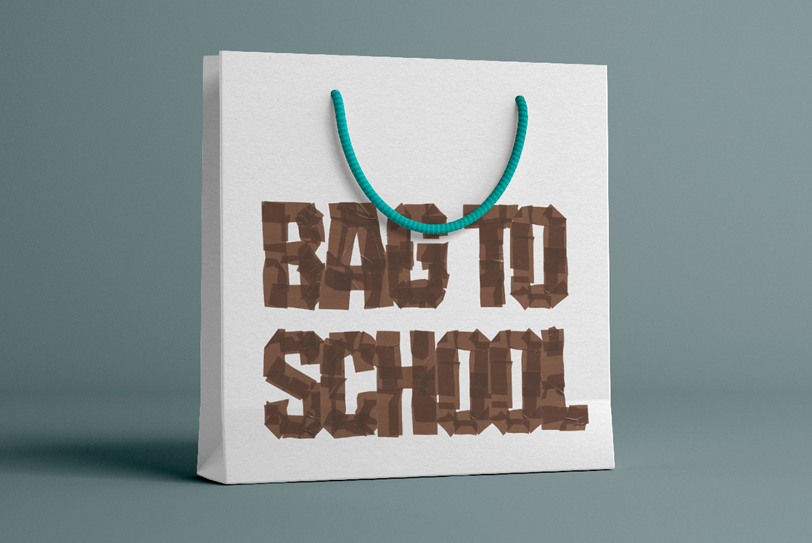 White shopping bag with Brown Tape Font. OpenType Typeface Made By Handmade Font