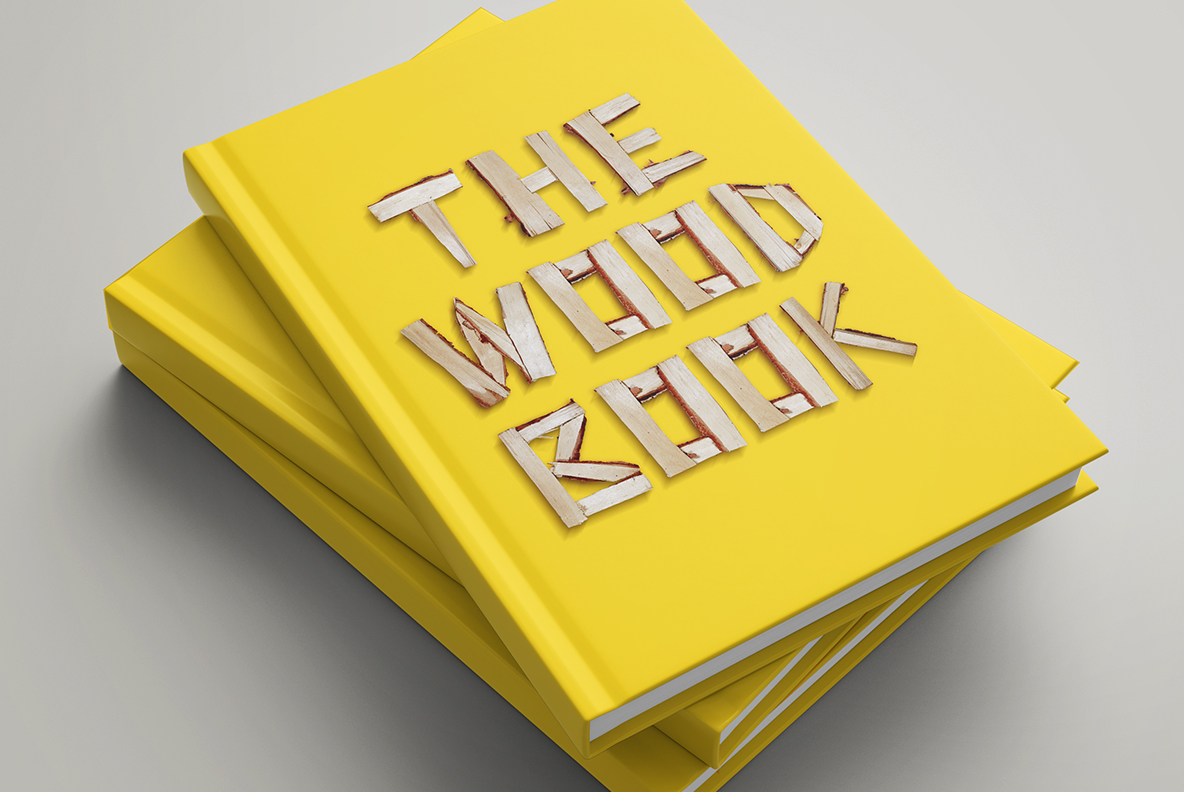 Yellow book cover with Log Font. Wooden OpenType Typeface Made By Handmade Font