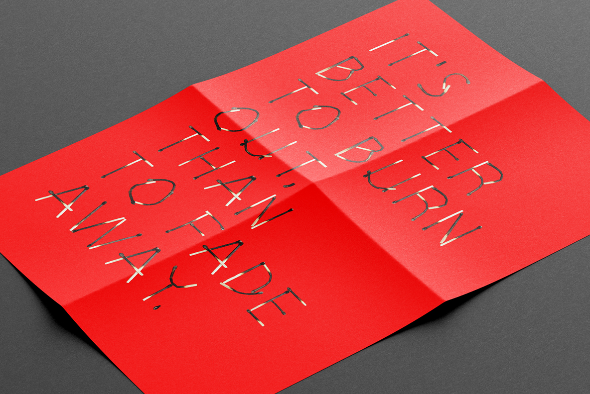 Matches Font OpenType Typeface SVG. Red poster with long text of burned font