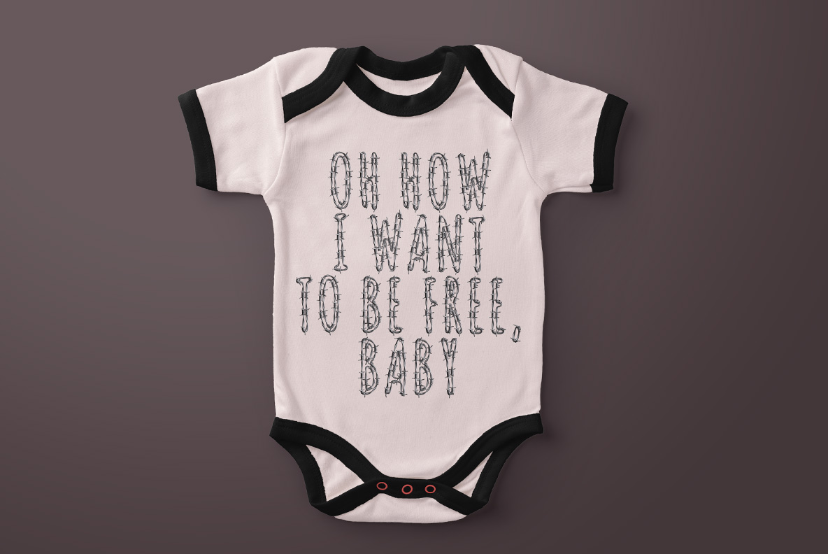 Baby t-shirt with Freedom Font. Wire OpenType Typeface Made By Handmade Font